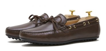 Driving shoe with a bow in dark brown shade. comfortable shoe for summer