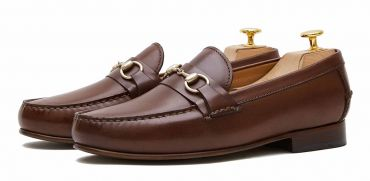 Loafers slip on buckle. Comfortable brown leather moccasins for summer
